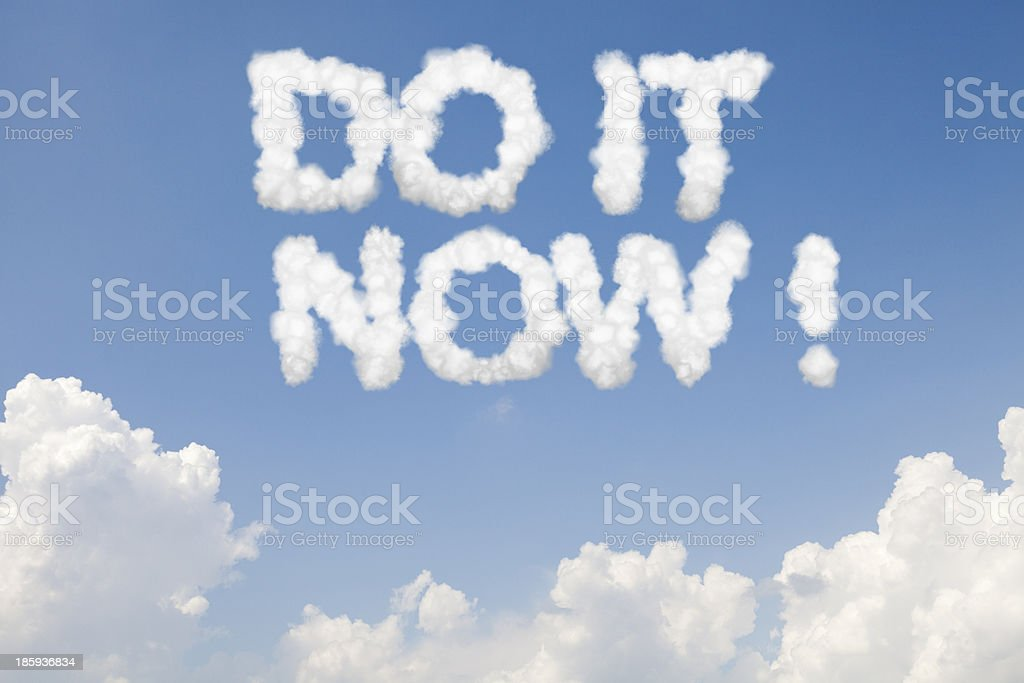 Do it now concept text in clouds royalty-free stock photo