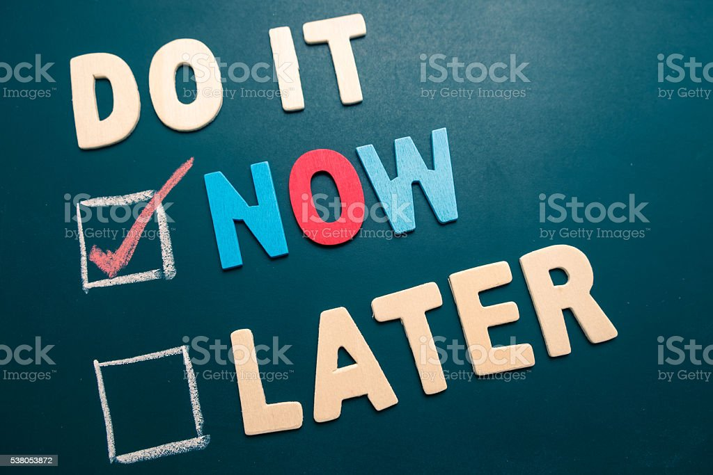 Do It Now or Later with checkbox and red check stock photo