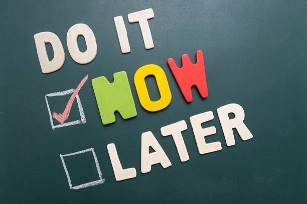 Do It Now or Later with checkbox on blackboard Time management concept - business concept - Do It Now or Later with checkbox and red marking on blackboard taking the plunge stock pictures, royalty-free photos & images