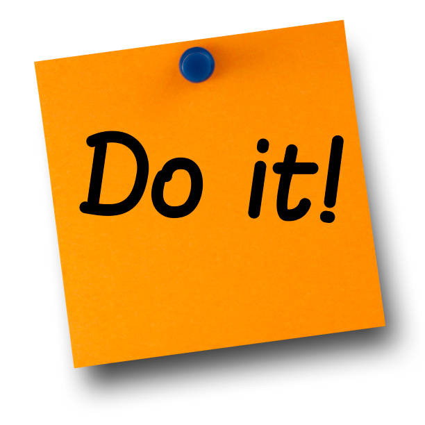 Do it orange postit affixed with blue small thumb tack on white Do it orange postit affixed with blue small thumb tack on white taking the plunge stock pictures, royalty-free photos & images