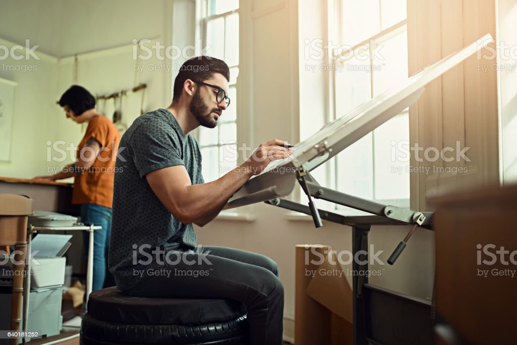 Shot of a team of graphic designers working on illustrations in their...