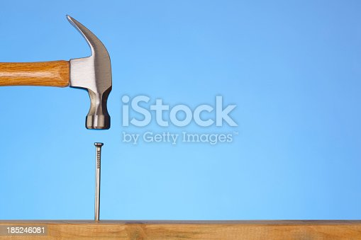 istock Do It Yourself; Hammer Hitting Nail On The Head 185246081