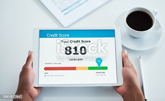 Shot of an unrecognizable businesswoman holding a digital tablet showing her credit score