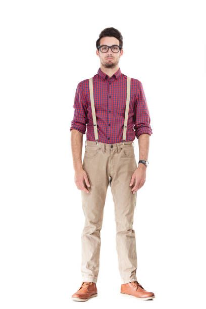 I do my style my way Studio portrait of a serious young man posing against a white background suspenders stock pictures, royalty-free photos & images
