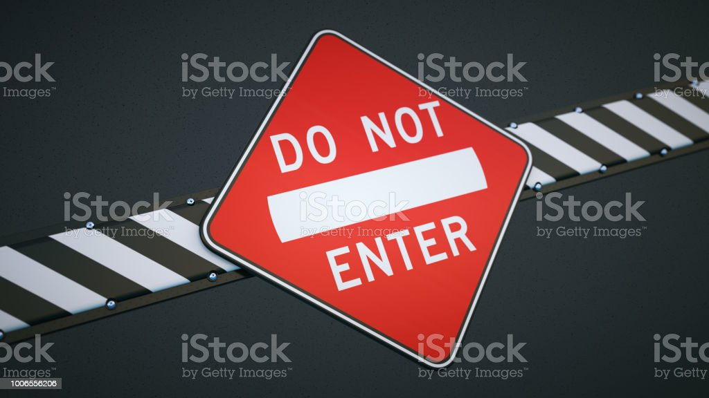 Do no enter sign & security barrier in black and white stripes isolated on black stock photo