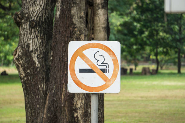 do not allow to smoking here in park stock photo
