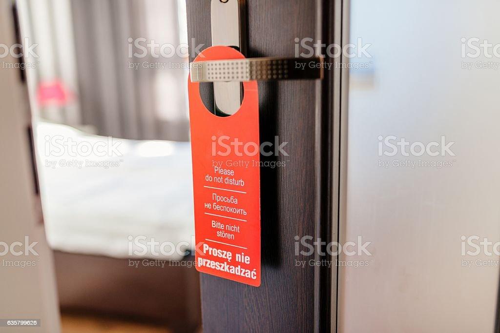 Do not disturb hotel door hanger on room doors stock photo