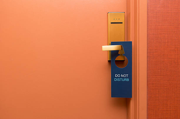 Do not disturb Do not disturb sign on hotel door inconvenience stock pictures, royalty-free photos & images