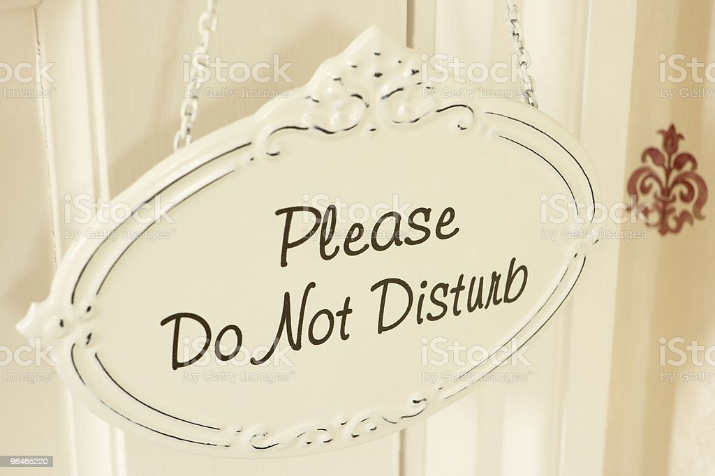 Do Not Disturb Sign Hanging On Door stock photo