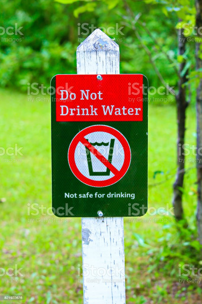 A do not drink water sign with a green background stock photo