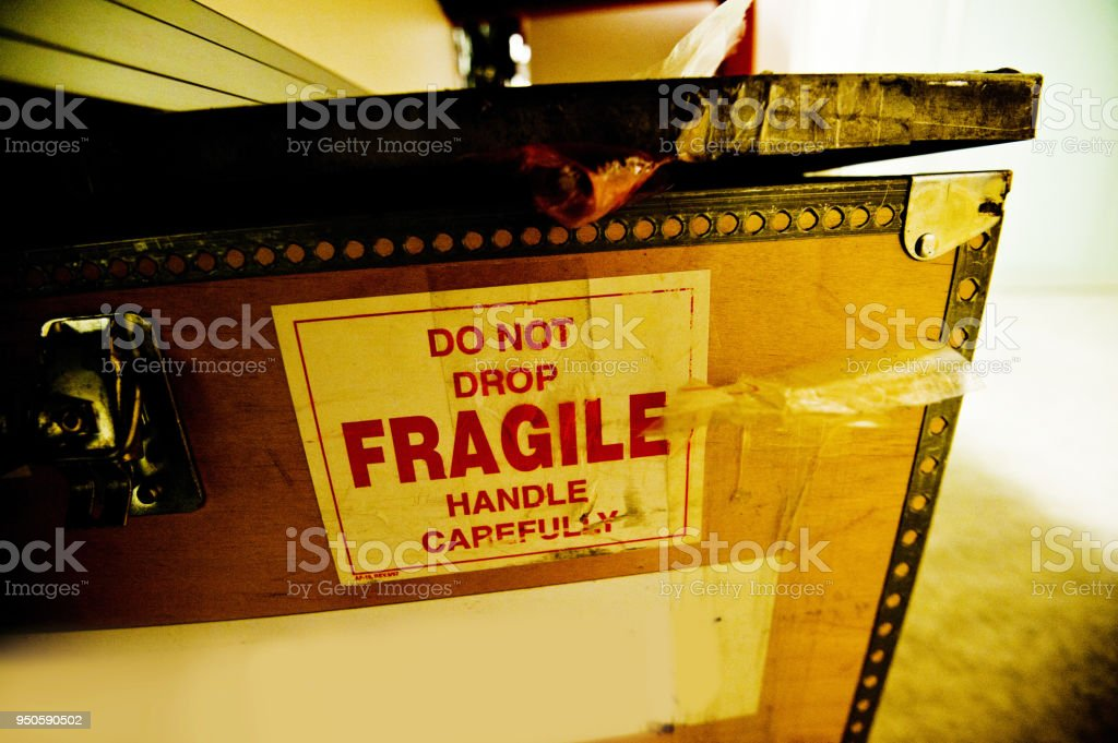 Do Not Drop. Fragile! Handle With Care Warning Sign On Old Brown...