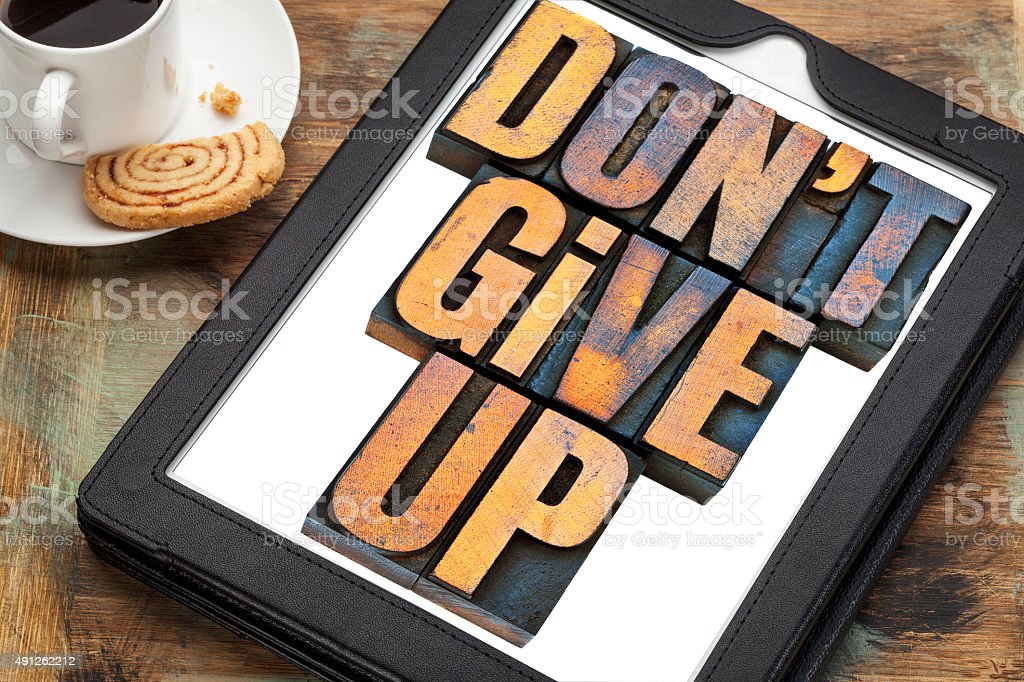 do not give up phrase on tablet stock photo