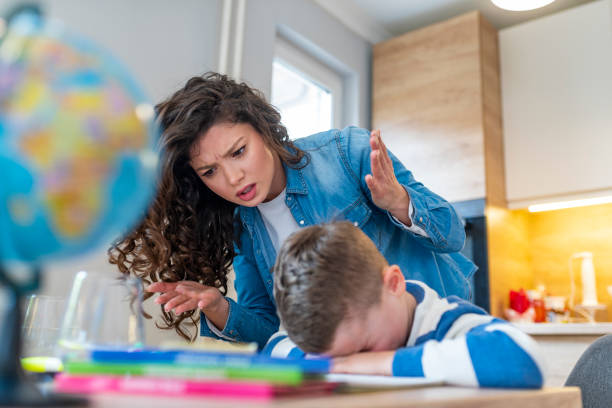 Do not ignore me when I am talking Do not ignore me when I am talking. Moms helping with homework. Mom is angry because her son dont want to do homework. Stressed mother and son frustrated over failure homework. AM stock pictures, royalty-free photos & images