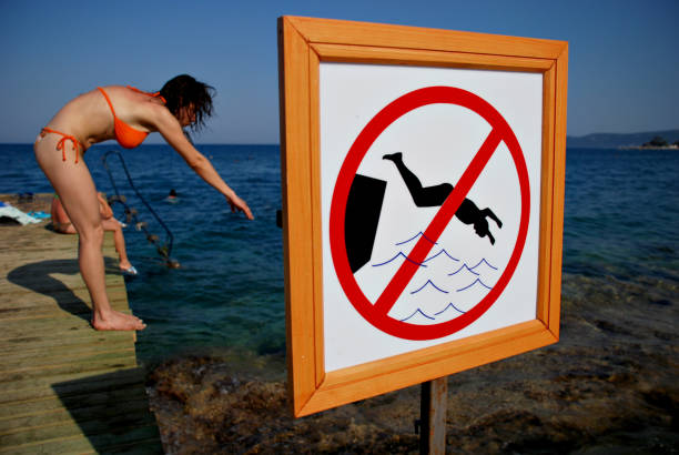 Do not jump in the water stock photo