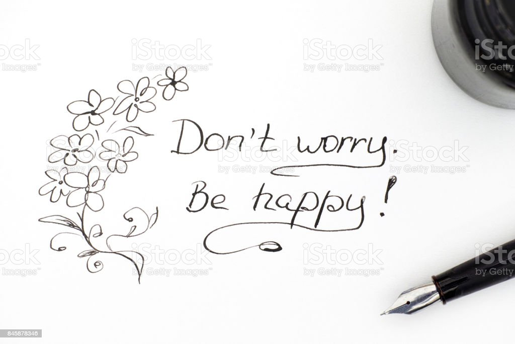 Do not worry. Be happy! with fountain pen and black ink. stock photo