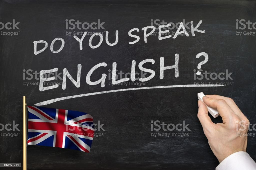 Do You speak English? Text written on blackboard. stock photo