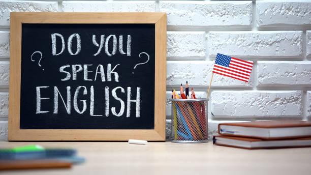 do you speak english written on board, international flag in box, language - english foto e immagini stock