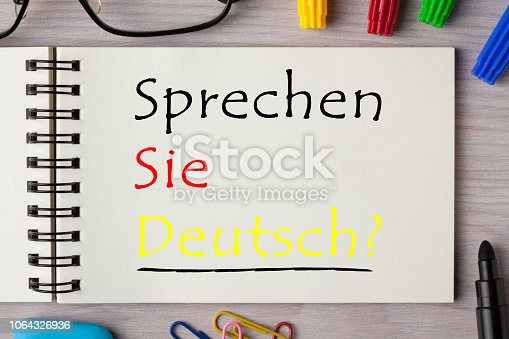 Do you speak German question (in German) written on notebook page with pen. Learning languages concept.