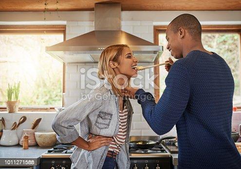 Shot of a man having his girlfriend taste his food