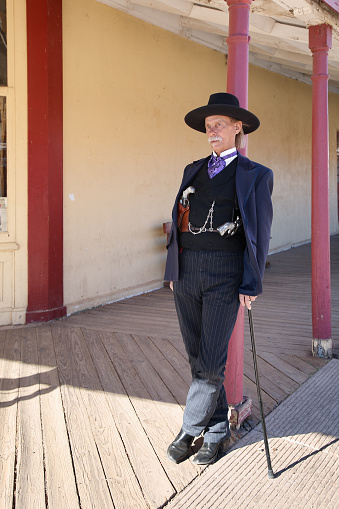 Tombstone, Arizona, Usa - February 3, 2008: The actor plays a gunslinger Doc Holliday standing on the porch of the street in Tombstone