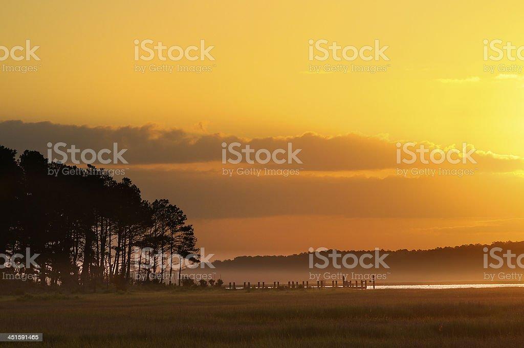Dock and Golden Sunrise stock photo