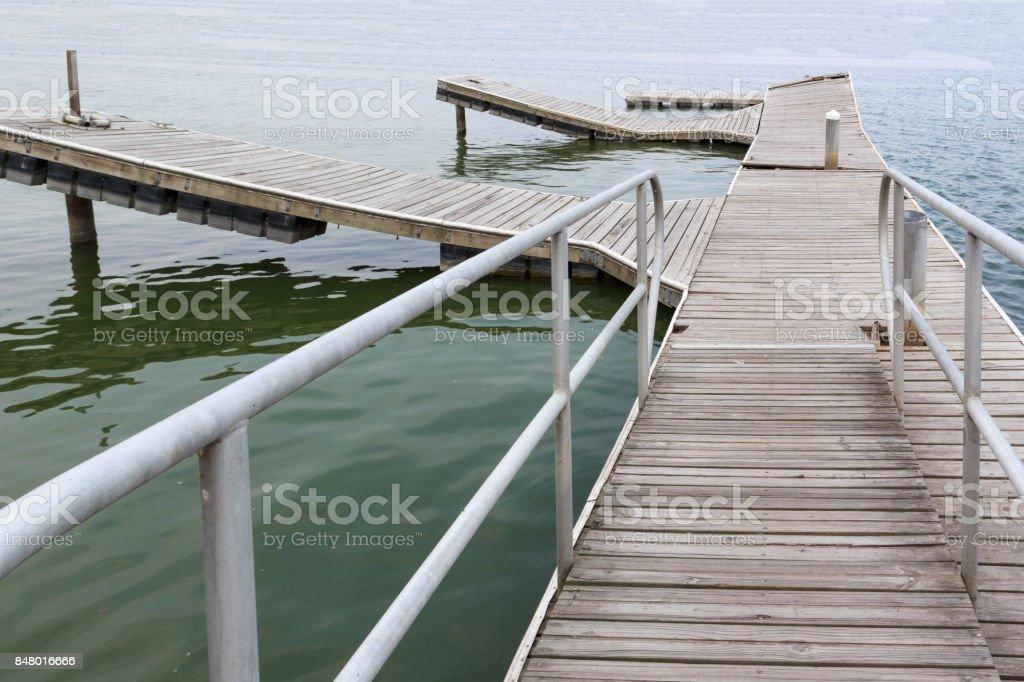 Dock boardwalk around seaside stock photo