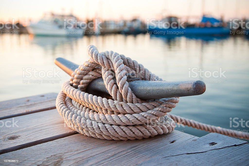 Dock cleat with boats at marina stock photo