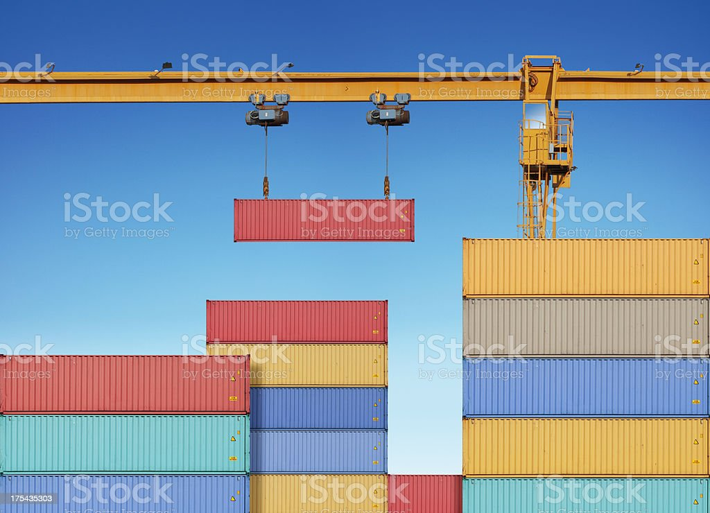 Dock crane lifting cargo container royalty-free stock photo