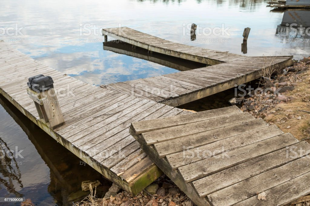 Dock Damaged from Winter Ice at the Lake royalty-free stock photo