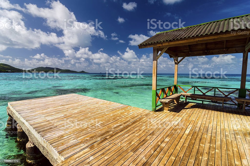 Dock in Turquoise Water stock photo
