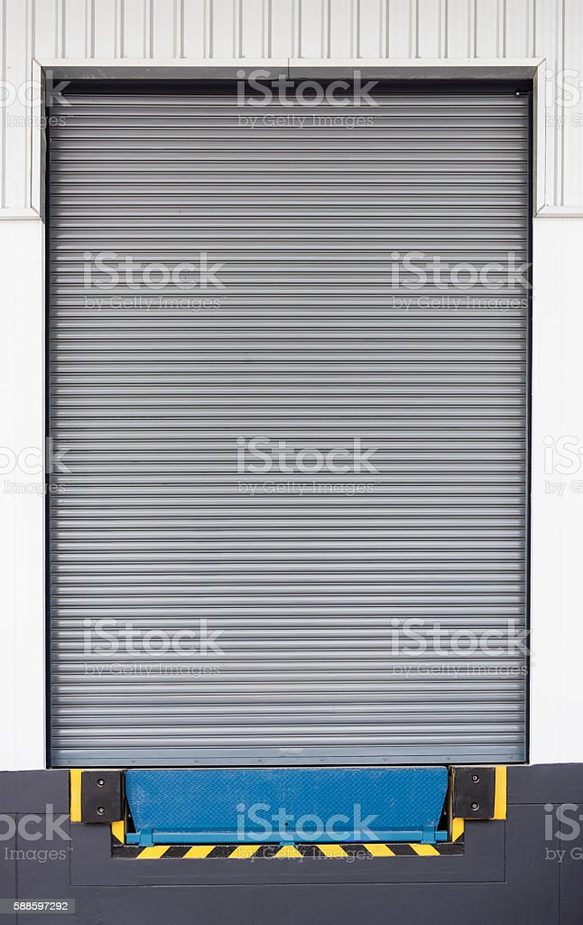 Dock leveler and shutter door, use for product transfer stock photo