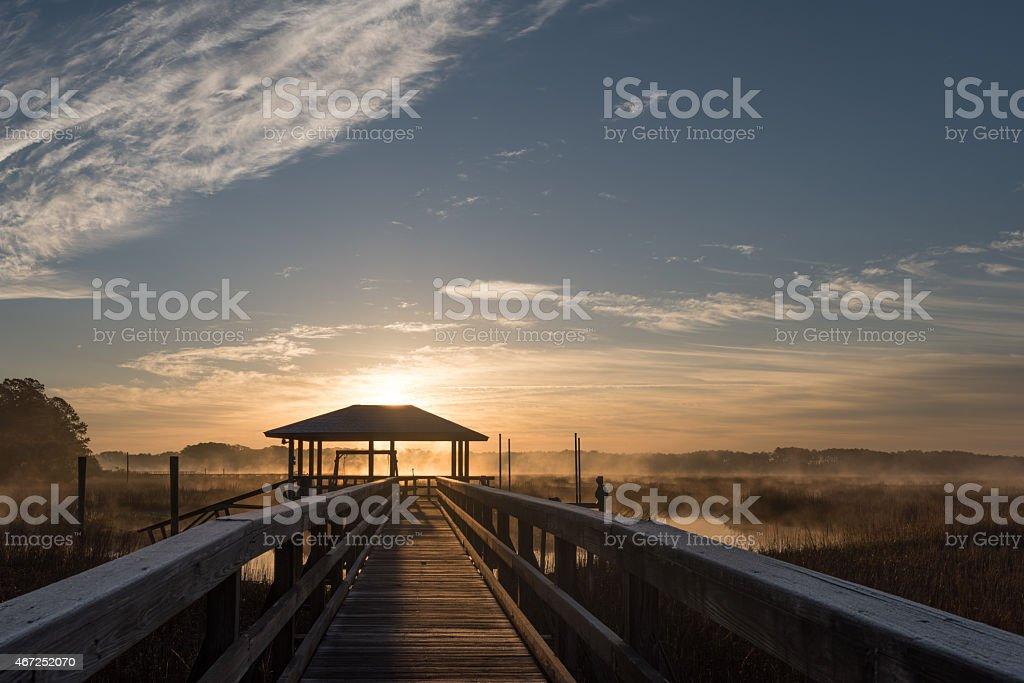 Dock near Hilton Head, Silhouetted Against the Rising Sun stock photo