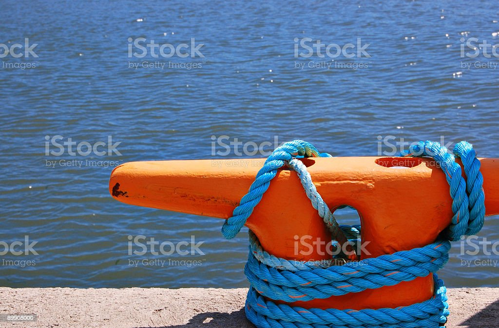 Dock with rope and pillar royalty free stockfoto