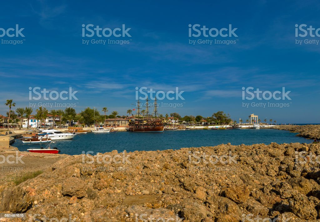 Dock with ships and temple of Apollo in Side, Antalya stock photo