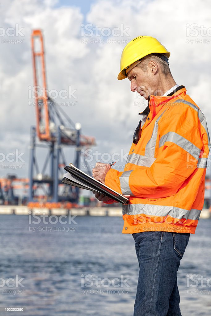 Dock worker with clipboard stock photo