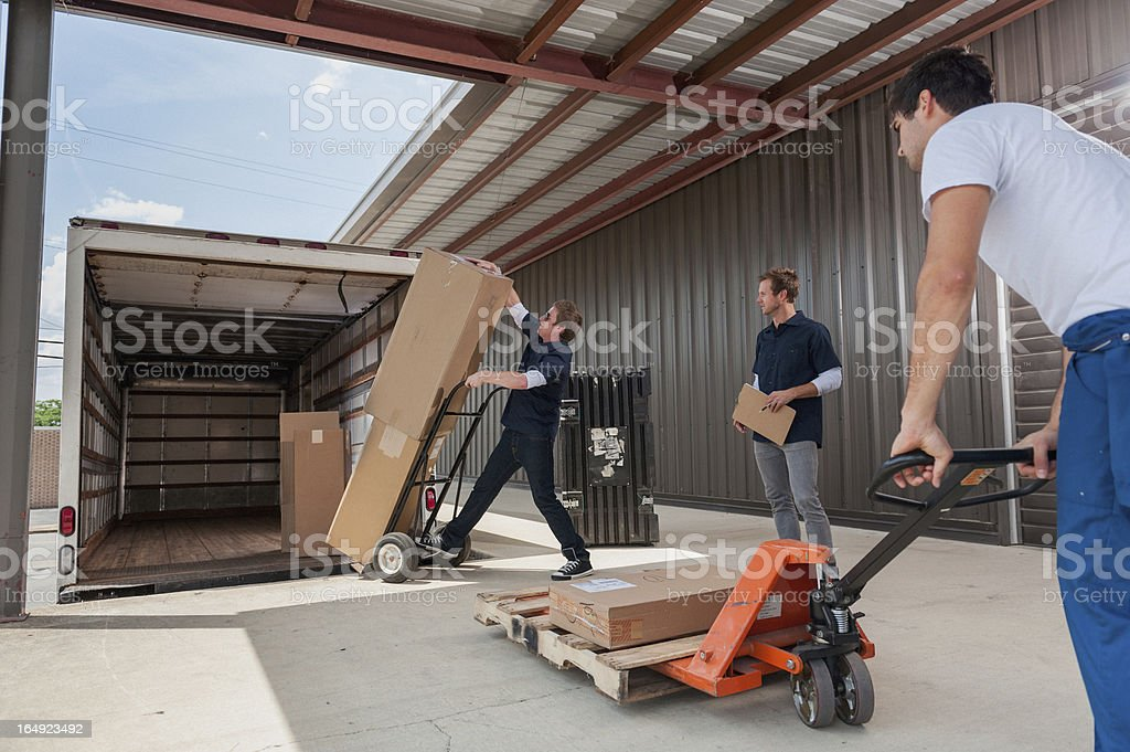 Dock Workers Loading A Delivery Truck royalty-free stock photo