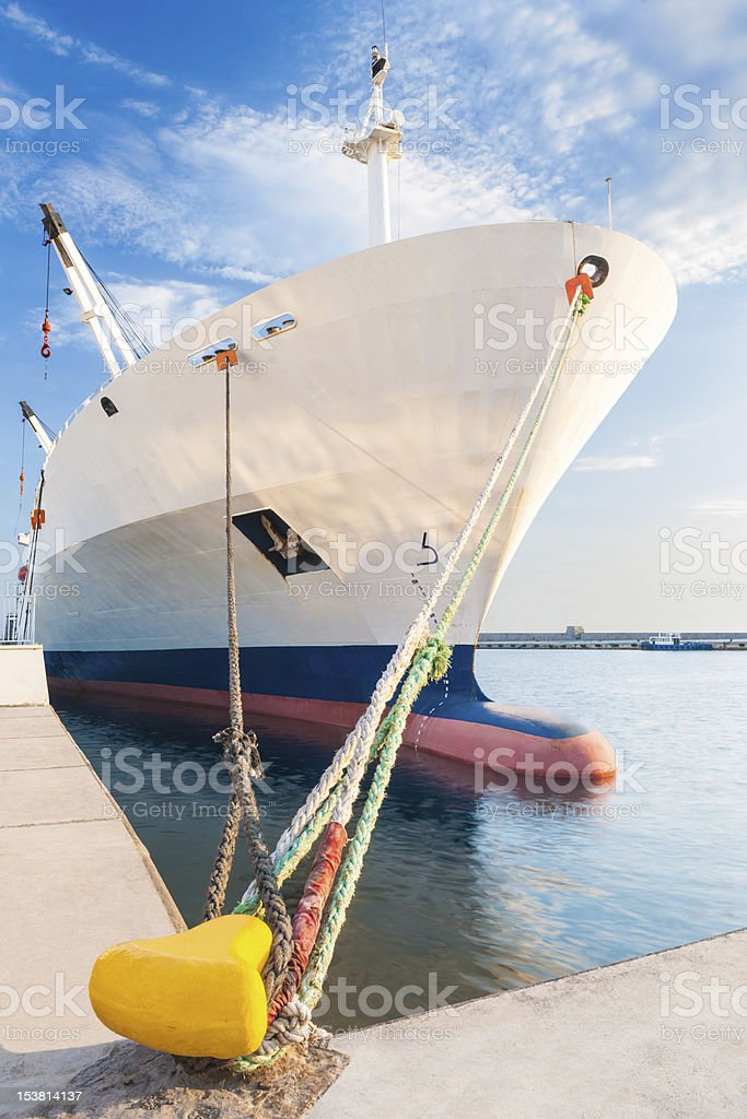 Docked dry cargo ship with bulbous bow stock photo