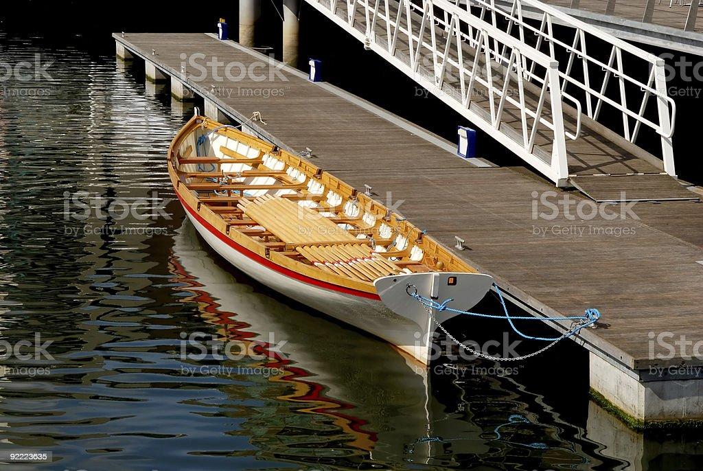 Docked gondola or longboat royalty-free stock photo