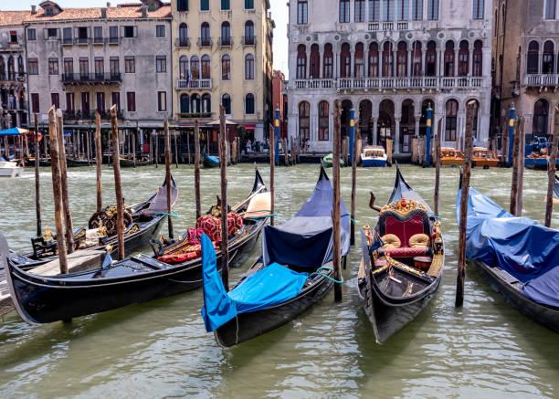 Docked gondolas in Venice, Italy stock photo