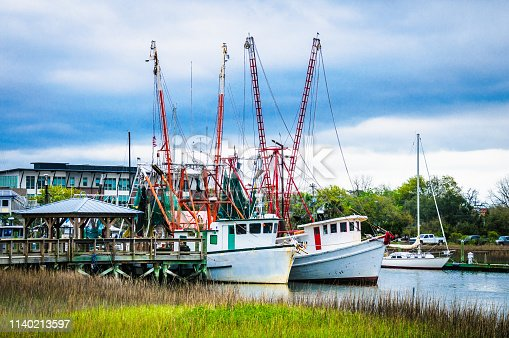 Two shrimp boats are docked in Shem Creek in Mount Pleasant, South Carolina after a days fishing.