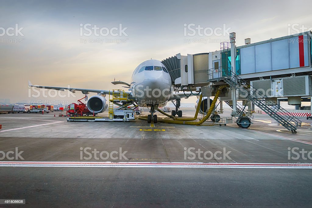 Docked jet aircraft in Dubai airport stock photo