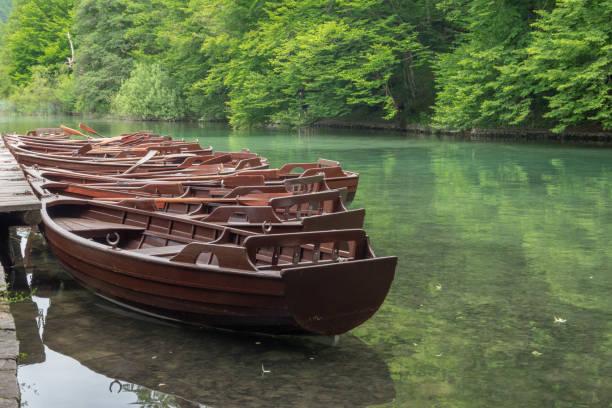 Docked rowboats stock photo