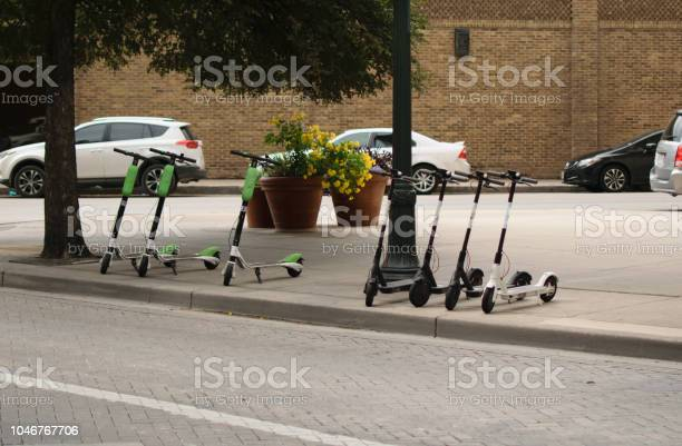 Dockless Electric Scooters on the Sidewalk in San Antonio