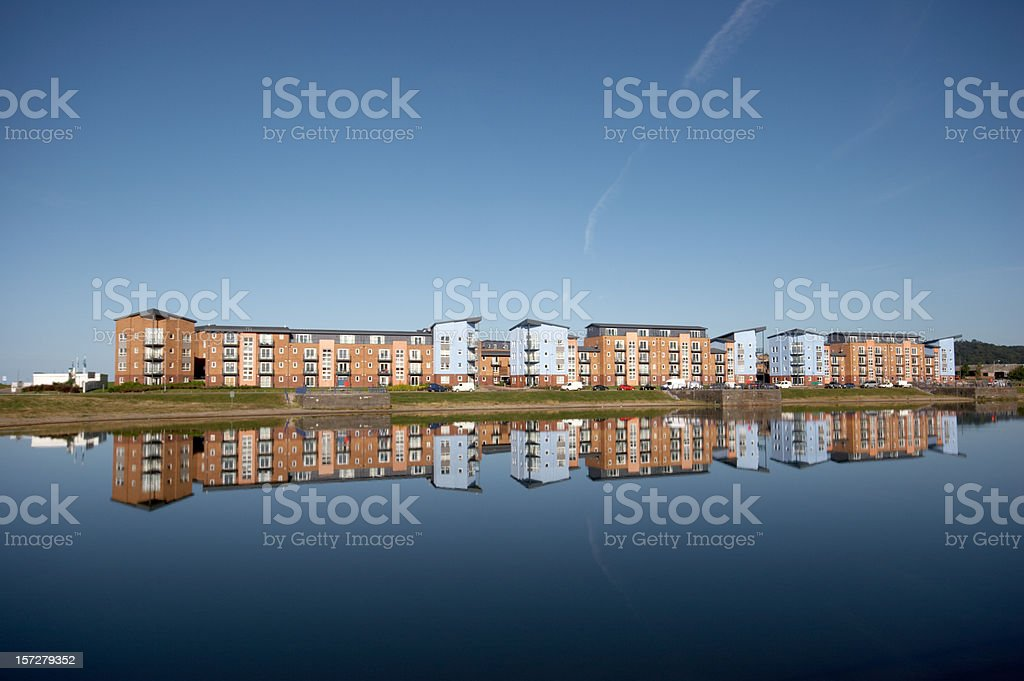 Dockside housing development and reflection royalty-free stock photo