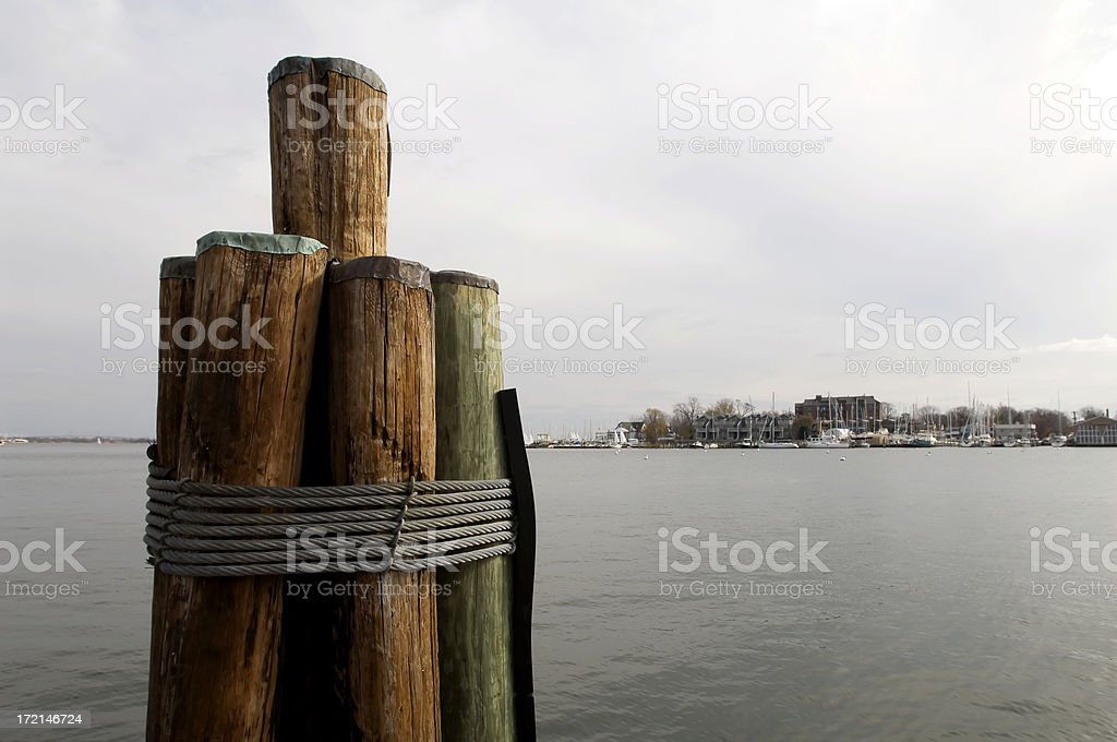 Dockside Wooden Pier Pilings Over Harbor stock photo