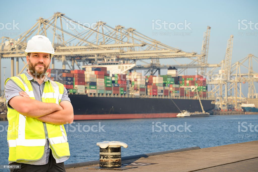 Dockworker at a container terminal in the harbour stock photo