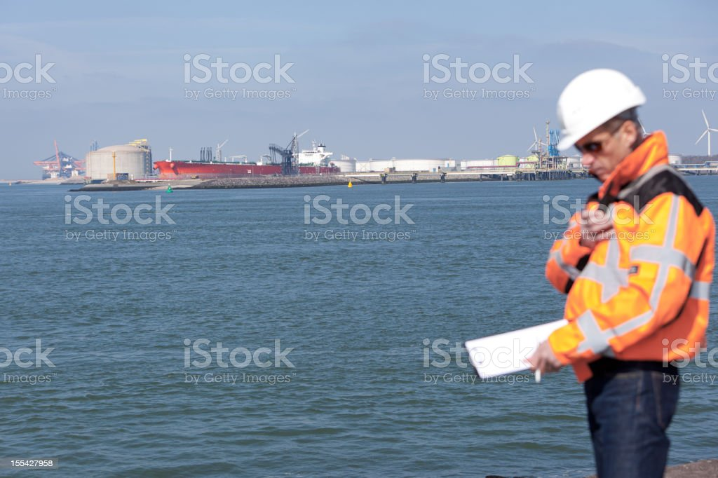 Dockworker giving instructions royalty-free stock photo