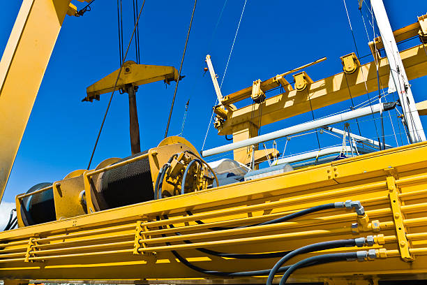 dockyard crane - cable winch stock photos and pictures