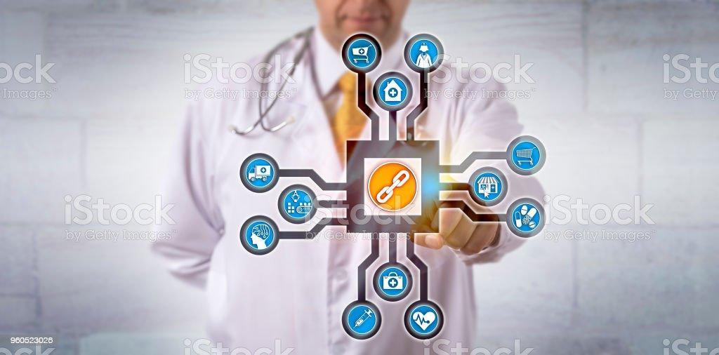 Doctor Activating Blockchain App In Cyberspace stock photo