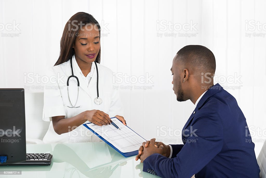 Doctor Advice To Young Patient stock photo